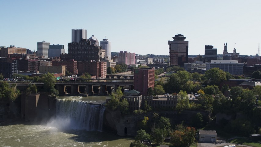 5.7K stock footage aerial video slowly approach falls and river bridges near skyline, Downtown Rochester, New York Aerial Stock Footage | DX0002_206_034