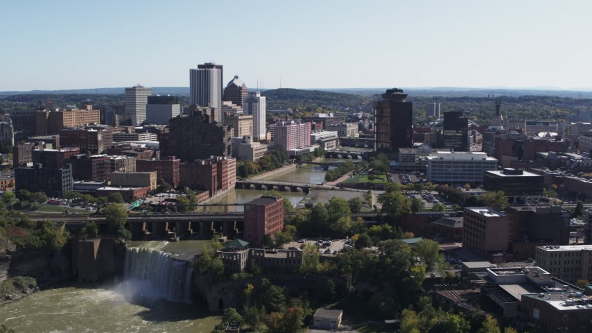 5.7K stock footage aerial video fly away from bridges and High Falls for view of skyline, Downtown Rochester, New York Aerial Stock Footage | DX0002_206_037