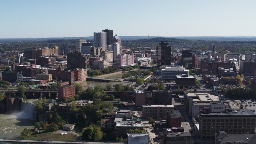 5.7K stock footage aerial video a wide view of High Falls, Genesee River and skyline, Downtown Rochester, New York Aerial Stock Footage | DX0002_206_038
