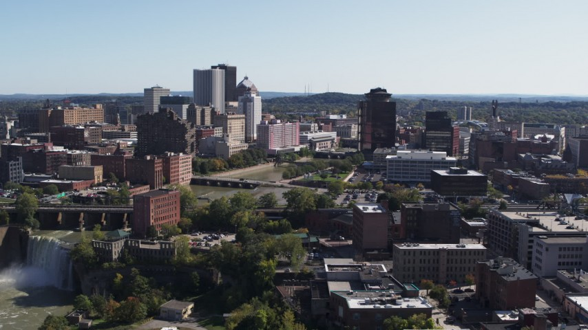5.7K stock footage aerial video of flying by High Falls, Genesee River and skyline, Downtown Rochester, New York Aerial Stock Footage | DX0002_206_039