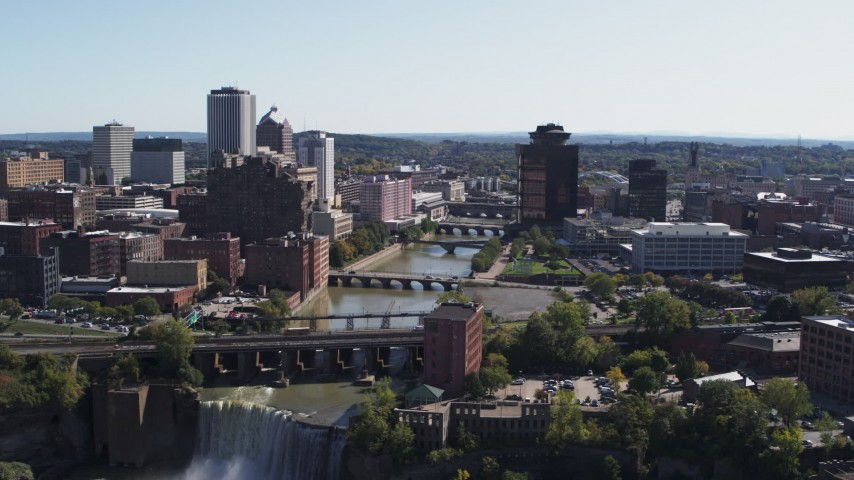 5.7K stock footage aerial video of flying over High Falls toward Genesee River bridges and skyline, Downtown Rochester, New York Aerial Stock Footage | DX0002_206_040