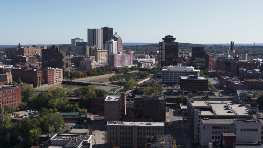 5.7K stock footage aerial video descend while focused on skyline and office tower, Downtown Rochester, New York Aerial Stock Footage | DX0002_206_042