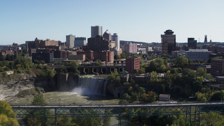 5.7K stock footage aerial video fly away from skyline and bridges near the falls, Downtown Rochester, New York Aerial Stock Footage | DX0002_207_001