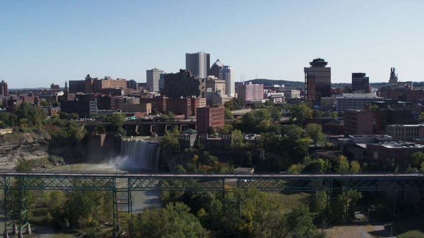 5.7K stock footage aerial video approach and flyby skyline and bridges near the falls, Downtown Rochester, New York Aerial Stock Footage   DX0002_207_002