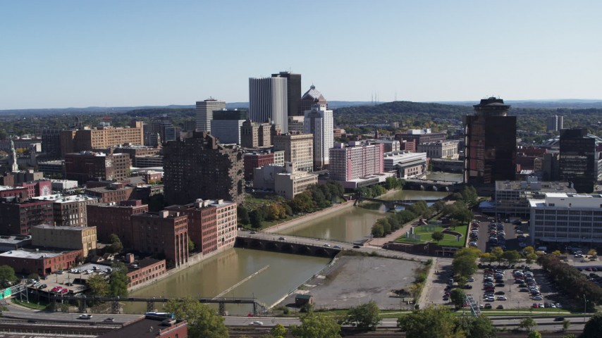 5.7K stock footage aerial video of flying by river bridges and skyline, Downtown Rochester, New York Aerial Stock Footage | DX0002_207_005
