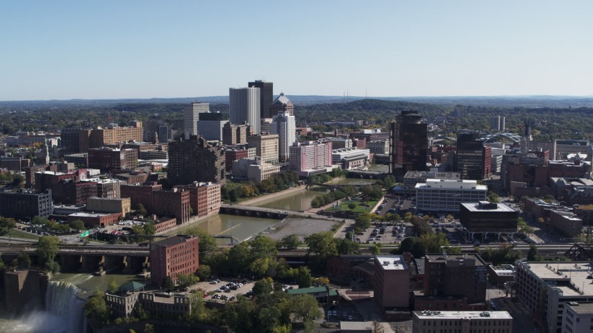 5.7K stock footage aerial video reverse view of river bridges and skyline, reveal the waterfall, Downtown Rochester, New York Aerial Stock Footage   DX0002_207_006