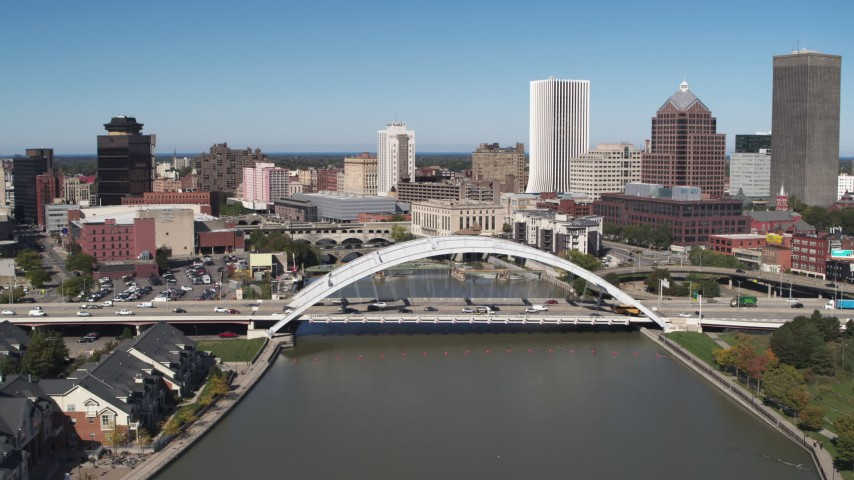 5.7K stock footage aerial video a reverse view of the skyline behind bridge, Downtown Rochester, New York Aerial Stock Footage | DX0002_207_010
