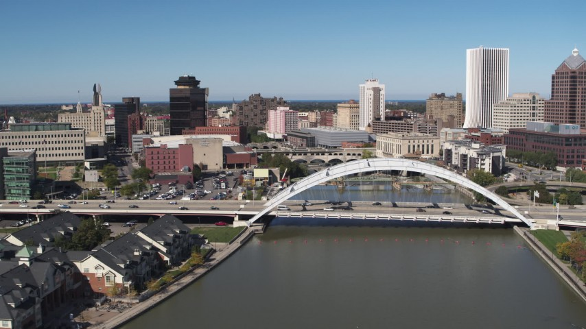 5.7K stock footage aerial video fly away from bridges over Genesee River in Downtown Rochester, New York Aerial Stock Footage | DX0002_207_018