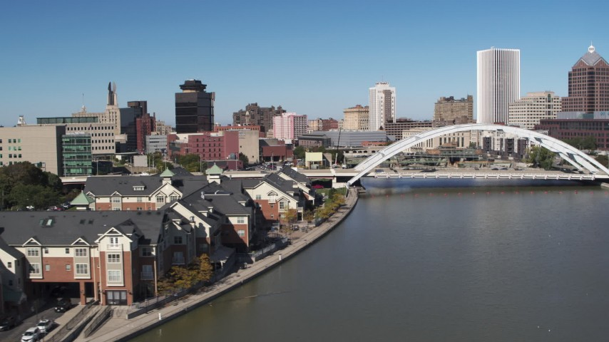 5.7K stock footage aerial video flyby riverfront apartments toward Douglass-Anthony Bridge in Downtown Rochester, New York Aerial Stock Footage | DX0002_207_019