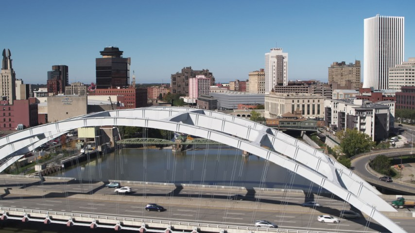 5.7K stock footage aerial video fly over Douglass-Anthony Bridge to reveal more bridges over Genesee River in Downtown Rochester, New York Aerial Stock Footage | DX0002_207_020