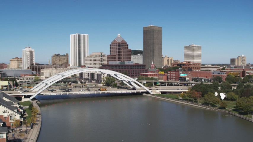 5.7K stock footage aerial video approach the skyline and Douglass-Anthony Bridge in Downtown Rochester, New York Aerial Stock Footage | DX0002_207_023