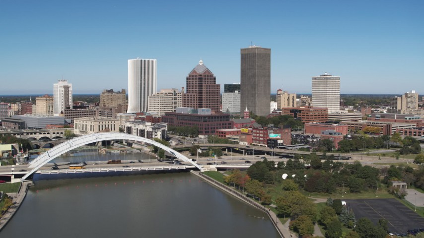 5.7K stock footage aerial video slowly fly away from the skyline and Douglass-Anthony Bridge, Downtown Rochester, New York Aerial Stock Footage | DX0002_207_025