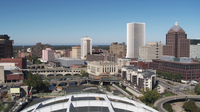 5.7K stock footage aerial video of bridges spanning Genesee River and The Metropolitan skyscraper, Downtown Rochester, New York Aerial Stock Footage | DX0002_207_027