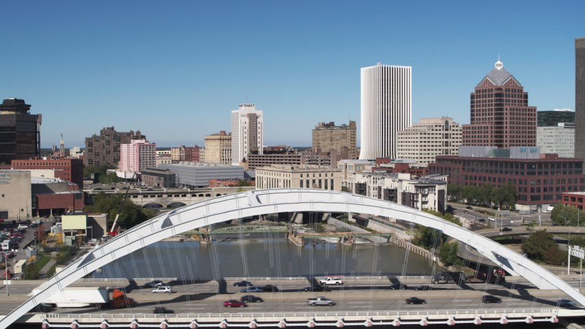 5.7K stock footage aerial video focus on high-rises while passing Douglass-Anthony Bridge, Downtown Rochester, New York Aerial Stock Footage | DX0002_207_029