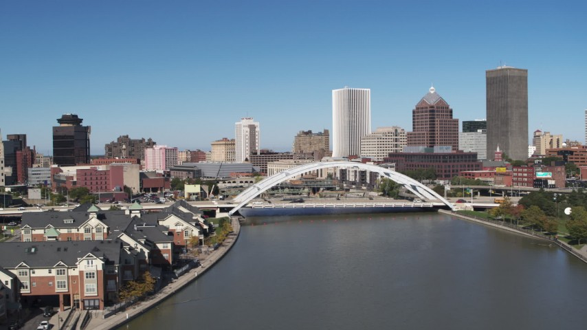 5.7K stock footage aerial video view of the skyline behind the Douglass-Anthony Bridge, Downtown Rochester, New York Aerial Stock Footage | DX0002_207_031