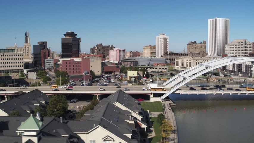 5.7K stock footage aerial video descend and flyby traffic on the Douglass-Anthony Bridge, Downtown Rochester, New York Aerial Stock Footage | DX0002_207_035