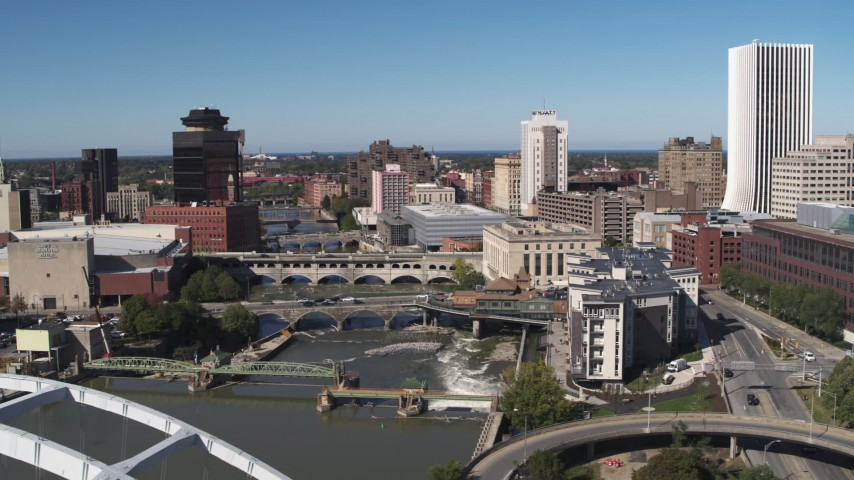 5.7K stock footage aerial video ascend past traffic on the Douglass-Anthony Bridge for view of river and Downtown Rochester, New York Aerial Stock Footage | DX0002_207_036