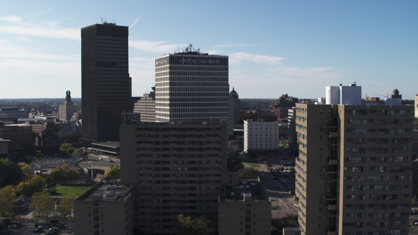 5.7K stock footage aerial video of Five Star Bank Plaza behind apartment building in Downtown Rochester, New York Aerial Stock Footage | DX0002_208_006
