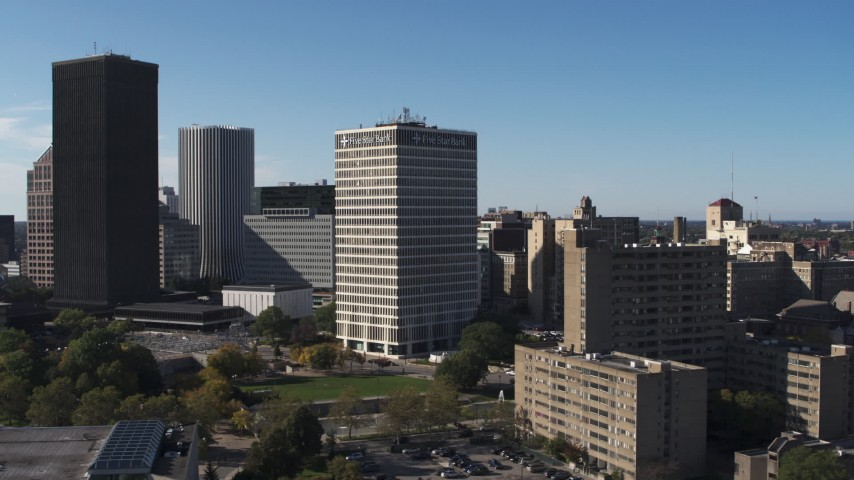 5.7K stock footage aerial video focus on Five Star Bank Plaza, flyby apartment complex in Downtown Rochester, New York Aerial Stock Footage   DX0002_208_008
