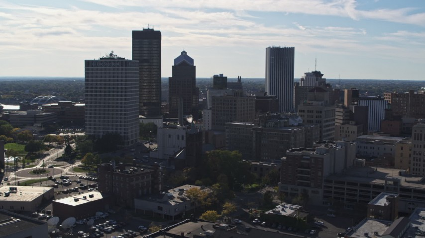 5.7K stock footage aerial video of the city skyline seen while flying near Five Star Bank Plaza, Downtown Rochester, New York Aerial Stock Footage | DX0002_208_011