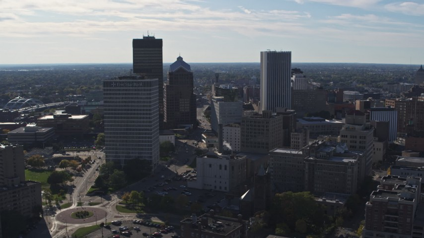 5.7K stock footage aerial video ascend and fly away from the city skyline, Downtown Rochester, New York Aerial Stock Footage | DX0002_208_012