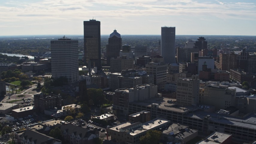 5.7K stock footage aerial video descend with view of the city skyline, Downtown Rochester, New York Aerial Stock Footage | DX0002_208_013