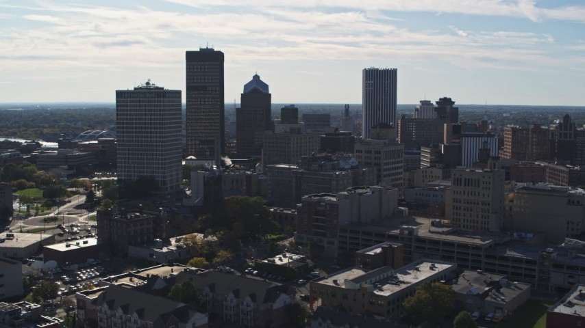 5.7K stock footage aerial video of ascending past the city skyline, Downtown Rochester, New York Aerial Stock Footage | DX0002_208_014