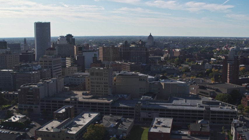 5.7K stock footage aerial video descend and flyby office buildings and parking garage, Downtown Rochester, New York Aerial Stock Footage | DX0002_208_015