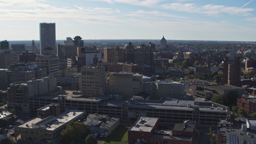 5.7K stock footage aerial video flyby office buildings and parking garage, Downtown Rochester, New York Aerial Stock Footage | DX0002_208_016