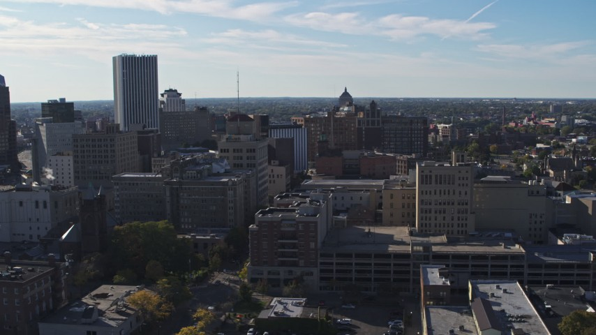 5.7K stock footage aerial video of passing office buildings and parking garage, Downtown Rochester, New York Aerial Stock Footage | DX0002_208_017