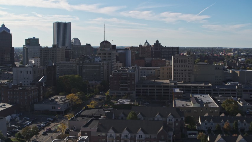 5.7K stock footage aerial video descend and pass by office buildings and parking garage, Downtown Rochester, New York Aerial Stock Footage | DX0002_208_018
