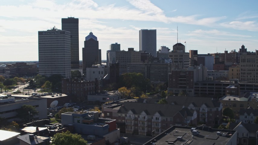 5.7K stock footage aerial video of the city skyline seen while ascending near Five Star Bank Plaza, Downtown Rochester, New York Aerial Stock Footage | DX0002_208_020