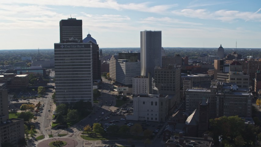 5.7K stock footage aerial video of the city skyline seen while flying near Five Star Bank Plaza, Downtown Rochester, New York Aerial Stock Footage | DX0002_208_021