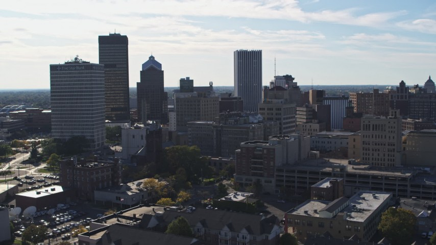5.7K stock footage aerial video focus on the city skyline while descending, Downtown Rochester, New York Aerial Stock Footage | DX0002_208_022