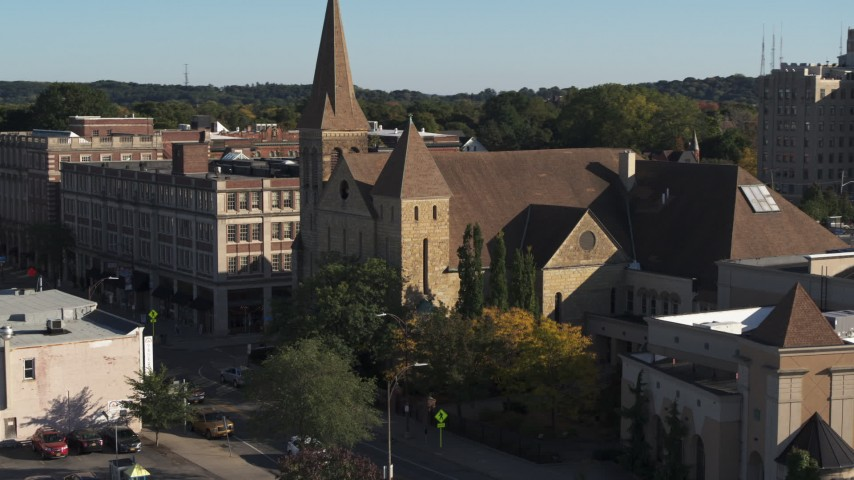 5.7K stock footage aerial video orbit and fly away from a church in Rochester, New York Aerial Stock Footage | DX0002_208_024