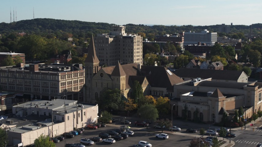 5.7K stock footage aerial video ascend while focused on a church in Rochester, New York Aerial Stock Footage | DX0002_208_025
