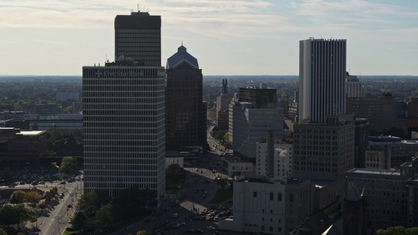 5.7K stock footage aerial video of ascending past skyscrapers and office towers in Downtown Rochester, New York Aerial Stock Footage | DX0002_208_031