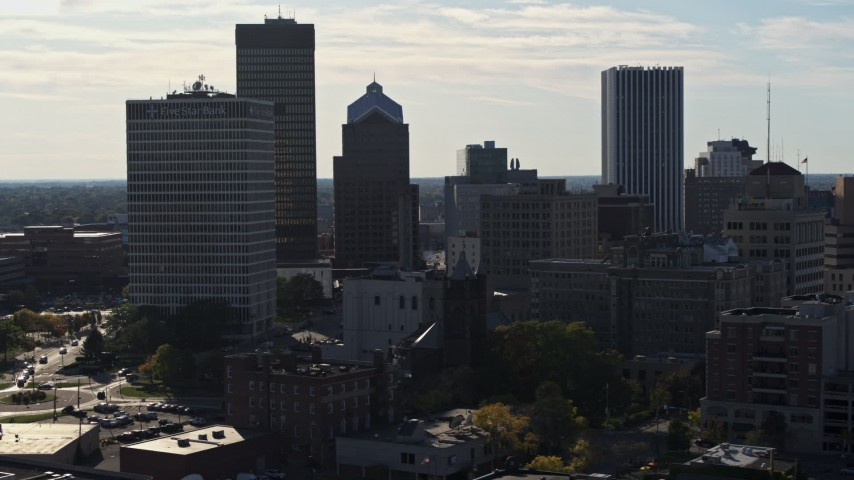 5.7K stock footage aerial video of descending past skyscrapers and office towers in Downtown Rochester, New York Aerial Stock Footage | DX0002_208_033