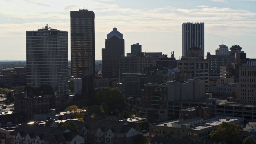 5.7K stock footage aerial video ascend while focused on skyscrapers and office towers in Downtown Rochester, New York Aerial Stock Footage | DX0002_208_034
