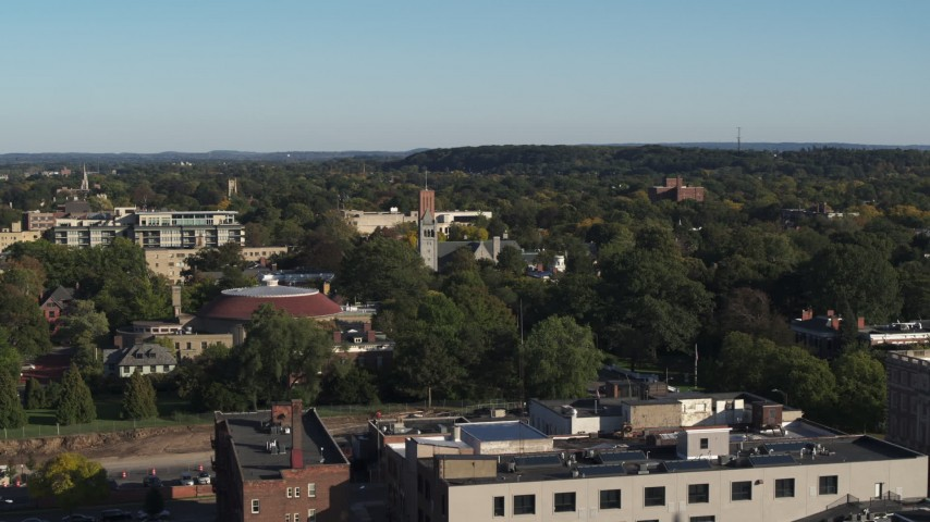 5.7K stock footage aerial video focus on church steeple during descent in Rochester, New York Aerial Stock Footage | DX0002_208_041