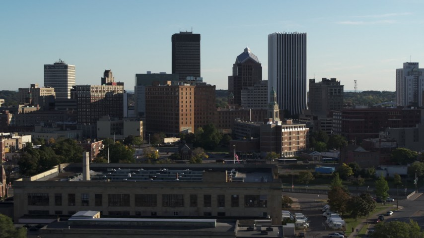 5.7K stock footage aerial video of skyscrapers and office towers behind apartment building, Downtown Rochester, New York Aerial Stock Footage | DX0002_209_001