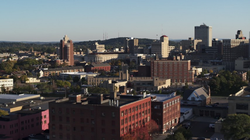 5.7K stock footage aerial video of flying by city buildings in Downtown Rochester, New York Aerial Stock Footage | DX0002_209_019