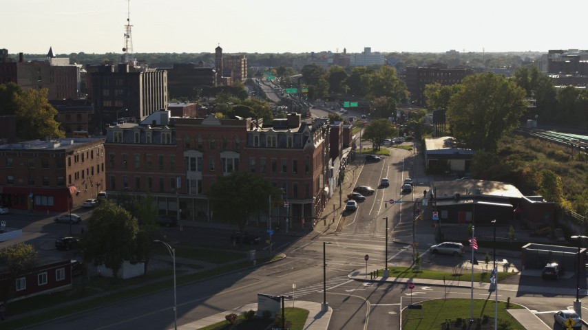 5.7K stock footage aerial video of a brick office building and Central Avenue in Downtown Rochester, New York Aerial Stock Footage | DX0002_209_022
