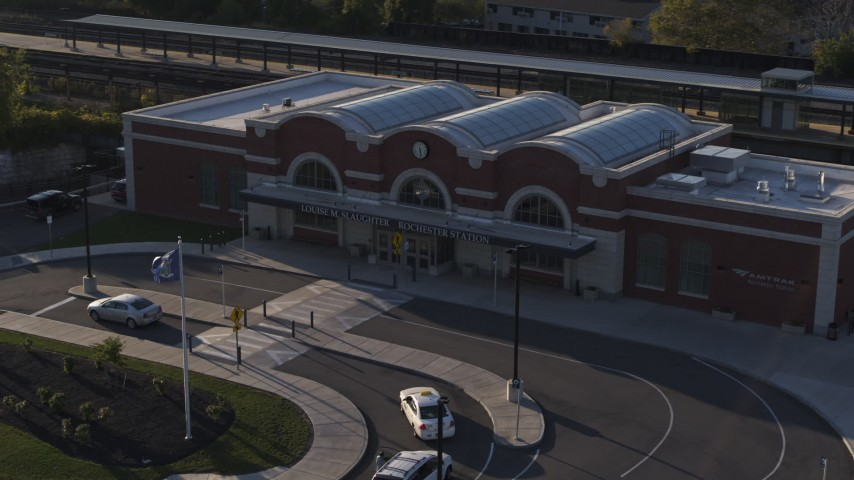 5.7K stock footage aerial video orbiting a brick train station at sunset in Downtown Rochester, New York Aerial Stock Footage | DX0002_209_023