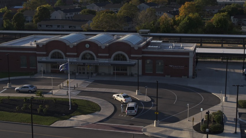 5.7K stock footage aerial video fly away from and orbit a brick train station at sunset in Downtown Rochester, New York Aerial Stock Footage | DX0002_209_024