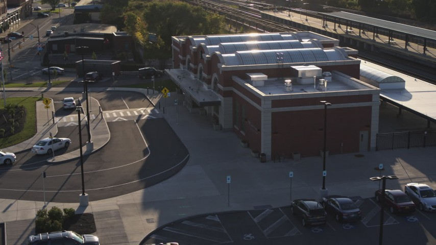 5.7K stock footage aerial video of circling a brick train station at sunset in Downtown Rochester, New York Aerial Stock Footage | DX0002_209_025