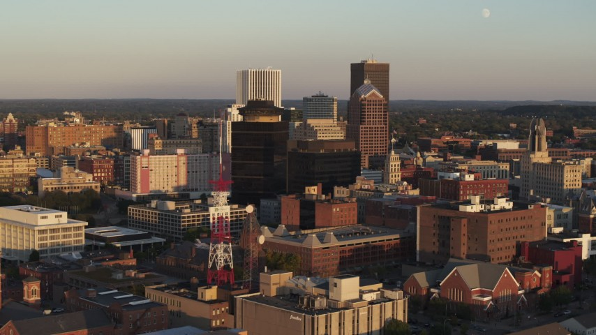 5.7K stock footage aerial video of flying by office buildings at sunset, Downtown Rochester, New York Aerial Stock Footage | DX0002_209_026