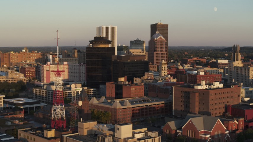 5.7K stock footage aerial video of flying by office buildings and a radio tower at sunset, Downtown Rochester, New York Aerial Stock Footage | DX0002_209_027