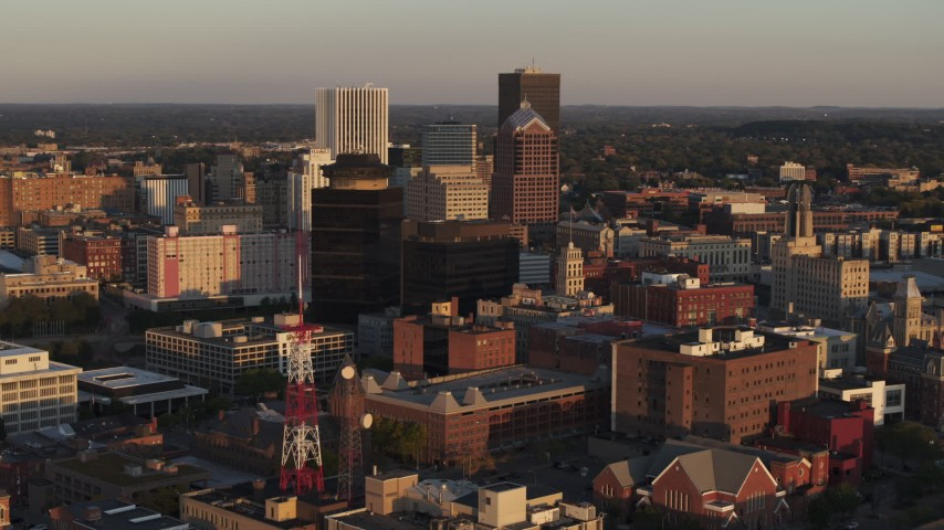5.7K stock footage aerial video of First Federal Plaza, office buildings, radio tower at sunset, Downtown Rochester, New York Aerial Stock Footage | DX0002_209_030