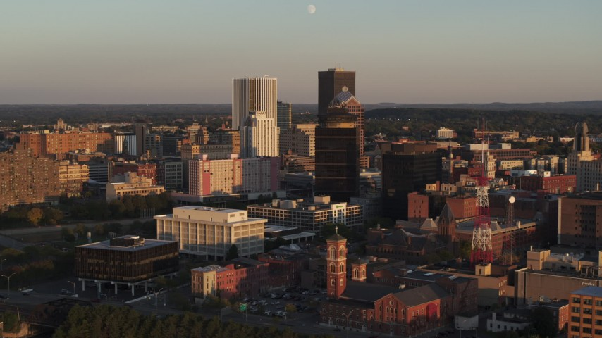 5.7K stock footage aerial video orbit First Federal Plaza and office buildings at sunset, Downtown Rochester, New York Aerial Stock Footage | DX0002_209_031
